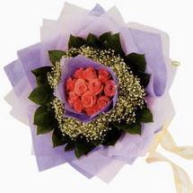 12 adet gül ve elyaflardan   Eskişehir çiçekçi mağazası