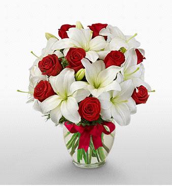 Eskişehir hediye çiçek yolla  1 dal kazablanka 11 adet kırmızı gül vazosu